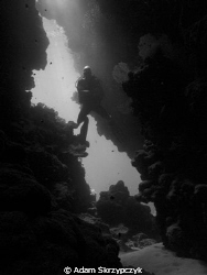 Diver entering a cave.  Shot witht he old oly 5060 by Adam Skrzypczyk 